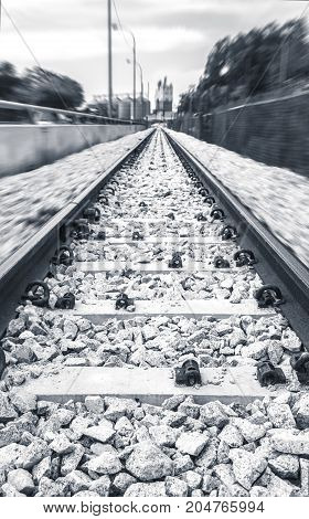 Poetic unusual railway surrounded by fast movement