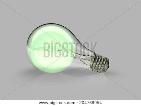 Conceptual lightbulb enlightened in green from inside