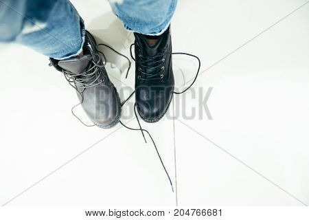 woman wants to buy new boots in the shop