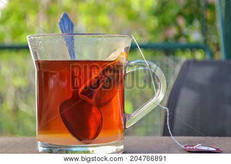 Hot warm tea in the tea cup whit spoon