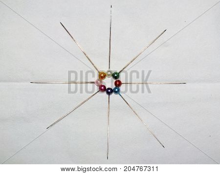 a collection of pin-needles with a colorful needle head