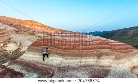 Nature photographer in red mountains at work