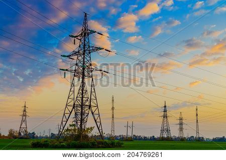 Power lines with beautiful sunset sky in rural area