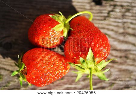 Fresh ripe strawberry on wooden table. Summer time