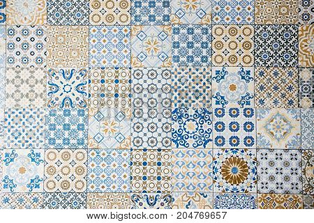 Real blue and yellow vintage tiles background and texture