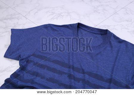 Blue stripe tshirt on white marble background