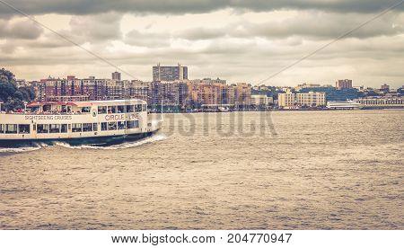 New Jersey USA - 28 September 2016: A Circle-Line Sightseeing Cruise Ship travels along the Hudson River through Hoboken.