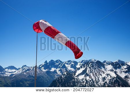 mountain range windsock and blue sky bavarian alps