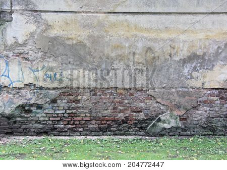 old and aged color graffiti drawing on the wall. Background grunge street art picture in Latvia Riga