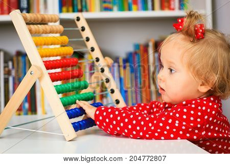 cute little girl playing with abacus, early child development