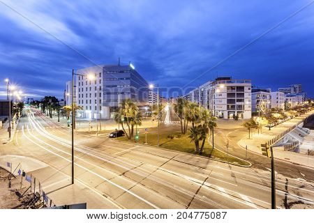 Streets in the city of Huelva illuminated at night. Andalusia Spain