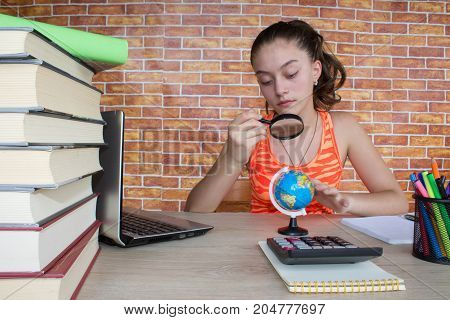Young Girl studying on desk at home. Thoughts education creativity concept. student Girl studying lessons