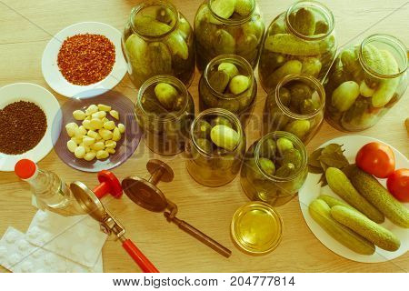 Preparation for pickling cucumbers. Fresh cucumber on the table. Preservation - Retro color