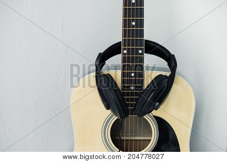 minimalistic composition of acoustic guitar and headphones