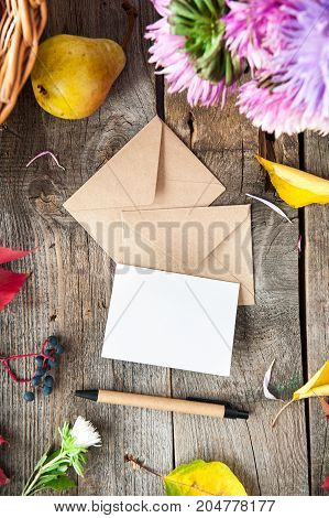 Thanksgiving Background With Seasonal Fruits, Flowers, Greeting Card, Few Craft Envelopes On A Rusti