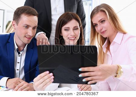 Group Of People In Office Look At Mobile Tablet Pc