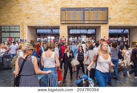 Passengers wait for departure at Florence Train Station - FLORENCE TUSCANY ITALY - SEPTEMBER 13, 2017