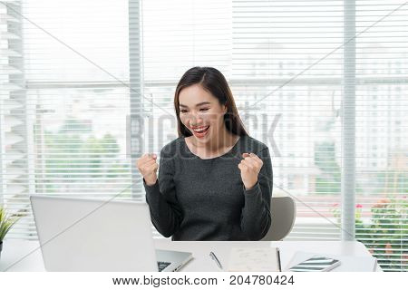 Single Young Excited Woman Celebrating Something With Both Arms Extended Upward