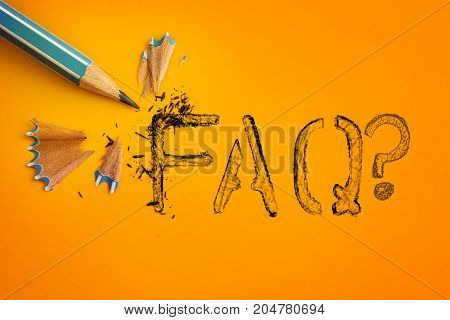 blue pencil on yellow orange background with FAQ text word creative innovation idea symbol concept