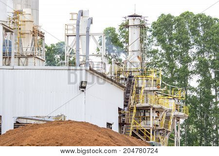 Biomass power plant is a tree background.