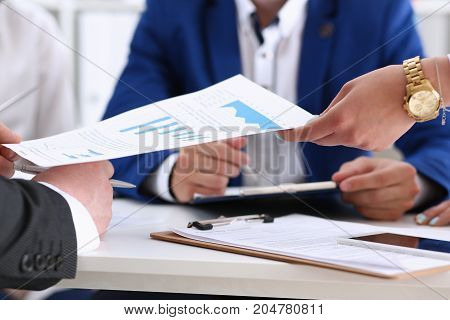Group Of People Discuss Financial Results At Workplace