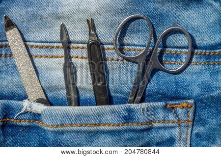 Basic Set Of Manicure Tools On Jeans Background
