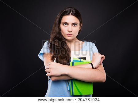 Serious Student Holding Her College Reading Books
