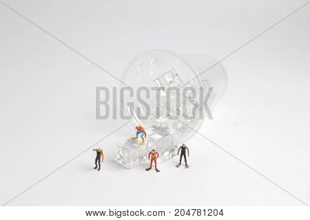 Tiny Divers On  The Cup Of Ice