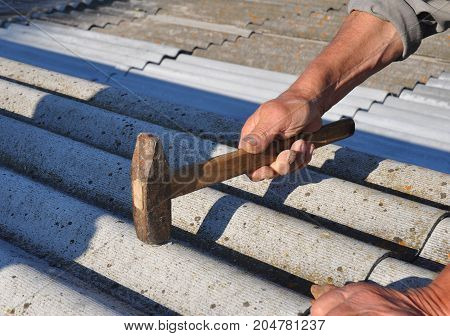 Roofer Repair Dangerous Asbestos Old Roof Tiles. Roofing Repair