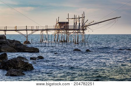 Traditional fisher hut trabocchi at sunset on Adriatic sea Abruzzo Italy