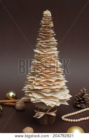 Decorated Rustic Christmas tree and gifts on white background