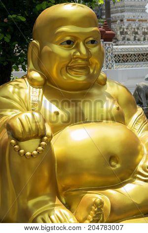 Golden buddha statue in the temple of the dawn Wat Arun in Bangkok