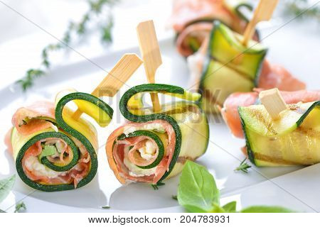 Zucchini appetizer rolls with delicious Italian ham and cream cheese with basil