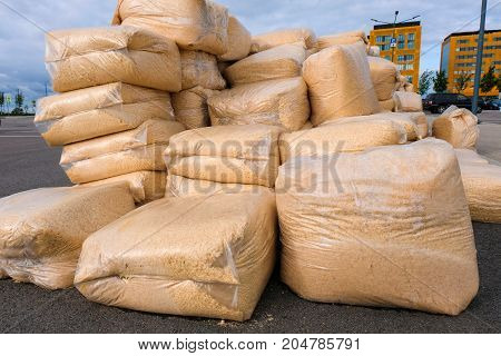 a large pile of wood chips in plastic bags