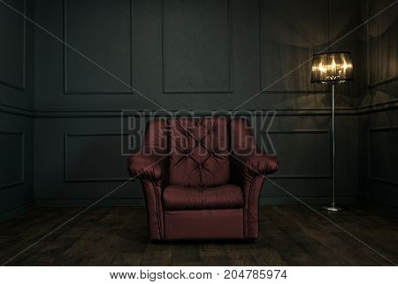 Empty red armchair in elegant dark room with copy space