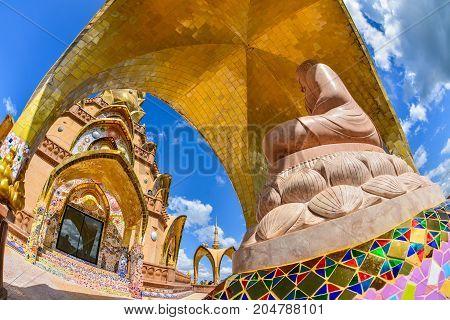 Beautiful brown buddha image with Beautiful church at Phasornkaew Buddhist temple travel destination in Phetchabun Thailand