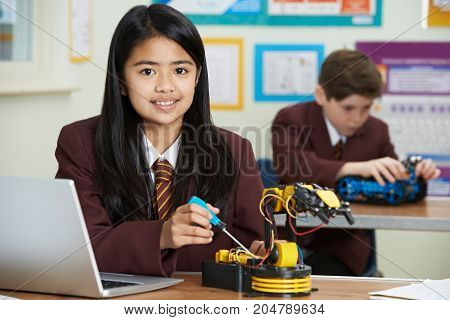 Portrait Of Female Pupil In Science Lesson Studying Robotics