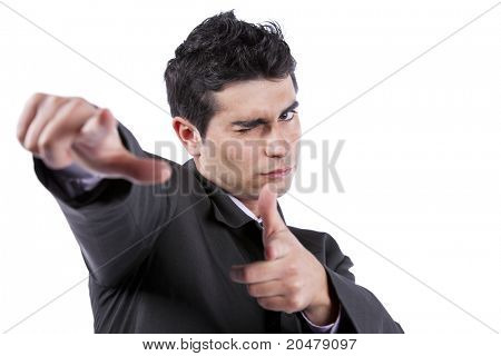 Young businessman blinking his eye and pointing to you (isolated on white)