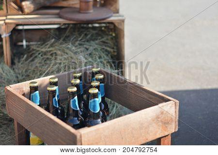 Group of beer bottles in wooden box
