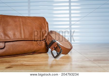 Vintage Travelling For Men's Accessories, Brown Bag And Belt Put On Modern Wooden Desk Table In The