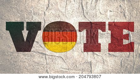 Vote word with Germany national flag. Grunge distress texture.