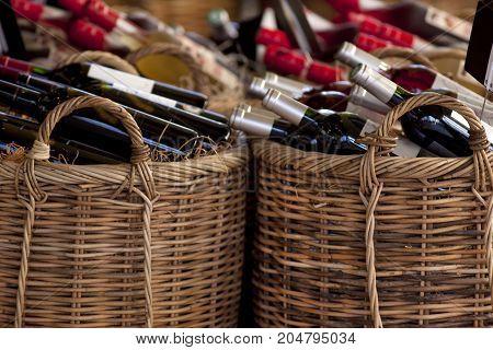 Red Wine Bottles In Baskets