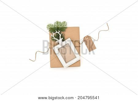 Christmas composition with gift and picture frame on white background. Flat lay
