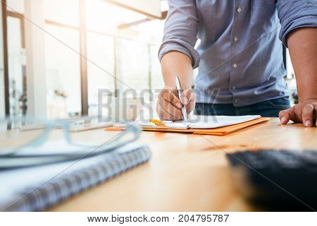 Business Man Using Calculator To Calculating.