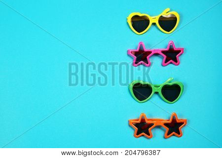 Various shapes of Sunglasses on blue background