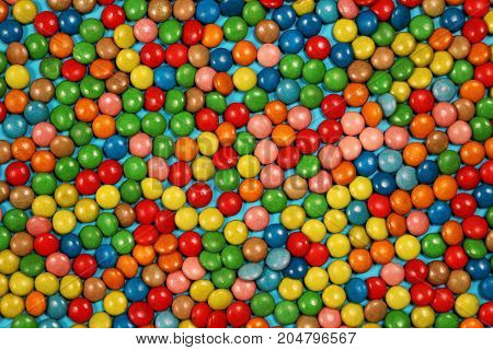 Multicolored candy and sweets background, top view