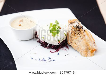 Chicken breast with mushroom sauce and rice