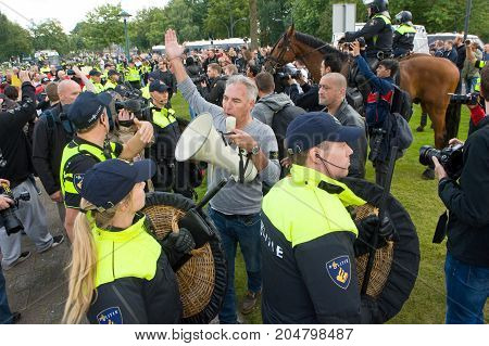 ENSCHEDE THE NETHERLANDS - SEPT 17 2017: Frontman Edwin Wagensveld of Pegida during an anti islam demonstration. Pegida is a group of people who are against the islamization of Europe.
