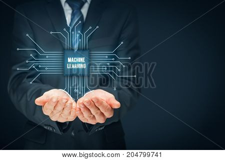 Machine learning data analysis concept. Businessman or programmer with abstract symbol of a chip with text machine learning connected with data represented by points.