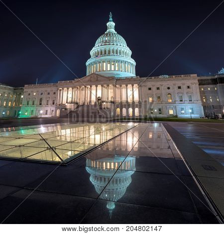 Washington DC, US Capitol Building at night with mirror reflection